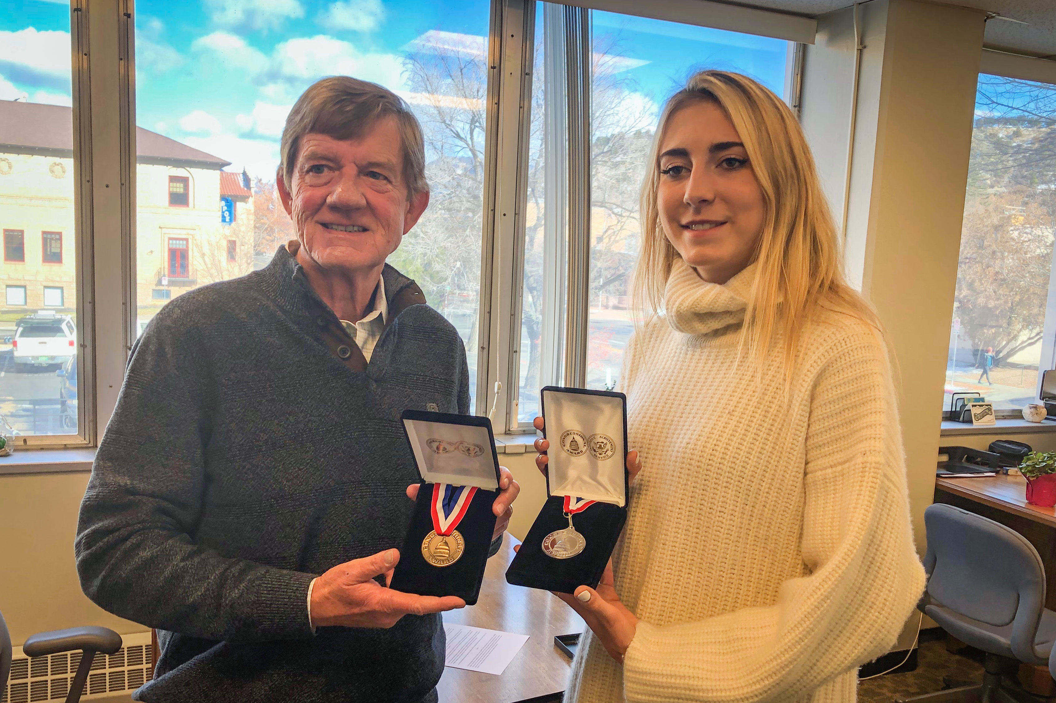 Republican Rep. Scott Tipton presents two Congressional Awards to Soleil Gaylord in his Durango, Colo., office, Nov. 26, 2019.
