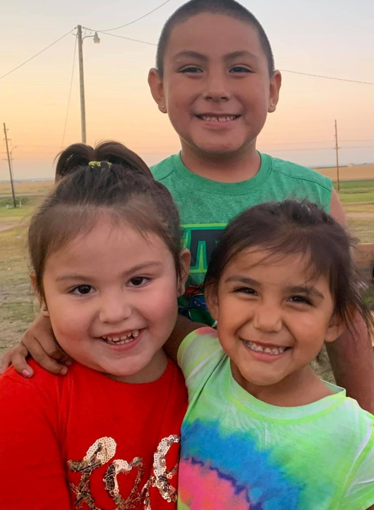Several kids at Pine Ridge Reservation after receiving gifts.
