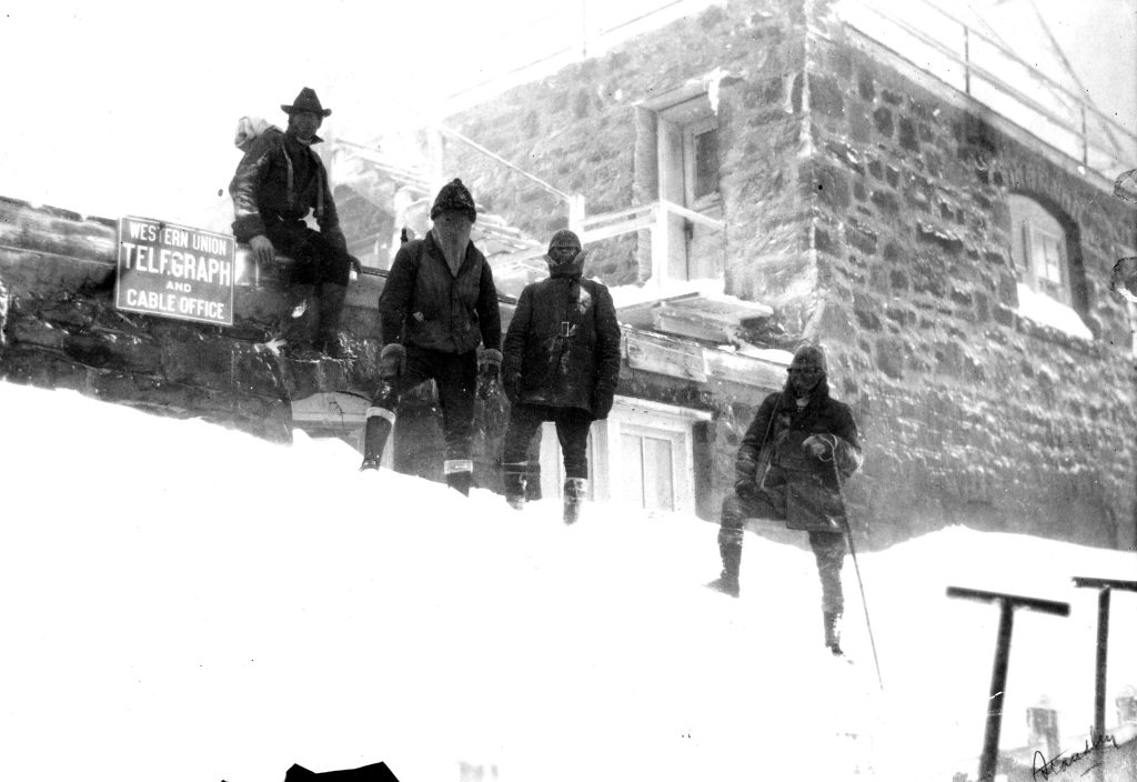 The AdAmAn Club stands near the summit house on Pikes Peak in 1922, marking their first trip up the mountain. The first members were Fred and Ed Morath, Fred Barr, Willis Magee and Harry Standley.