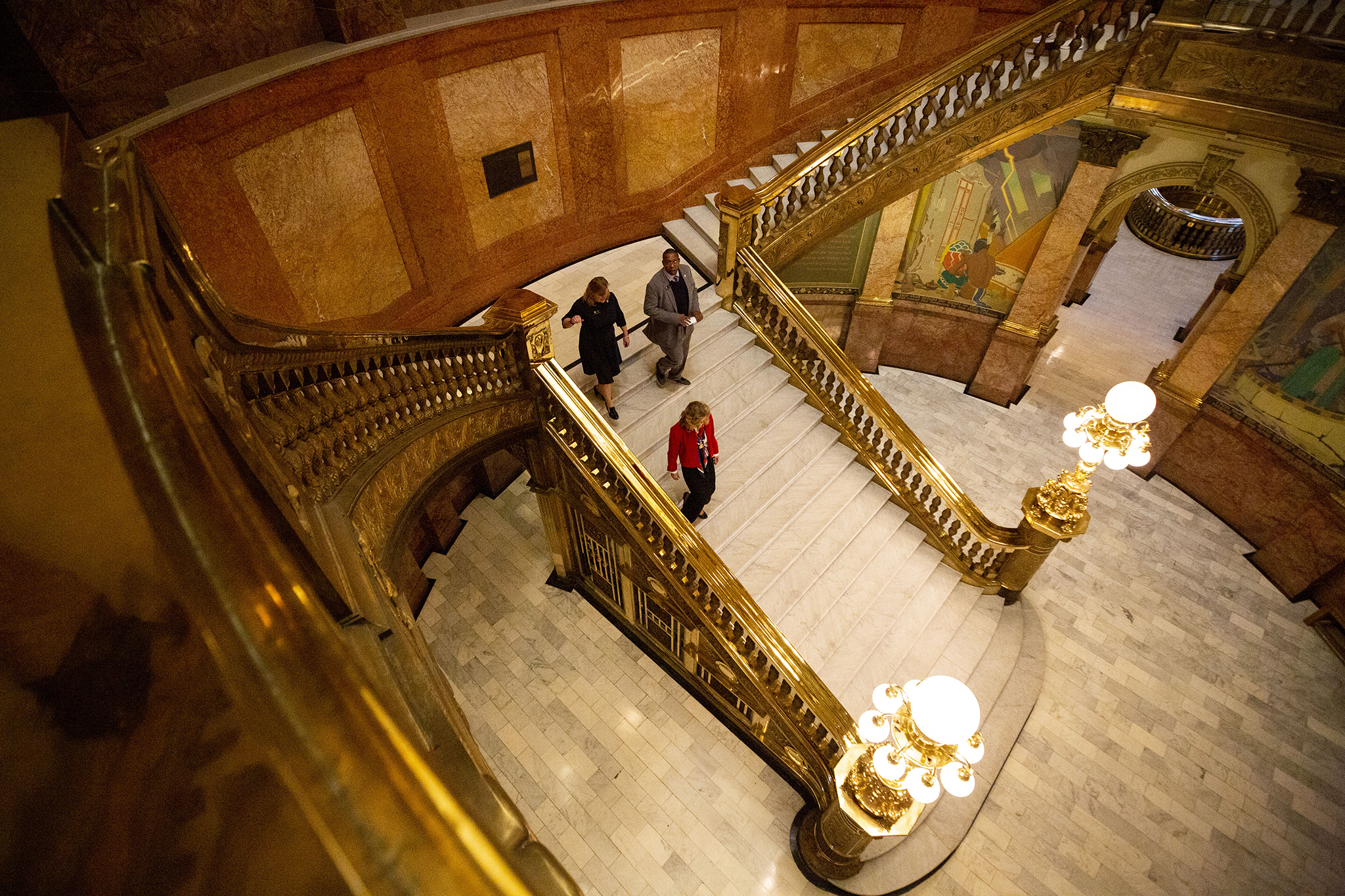 State Reps. Meg Froelich, Jovan Melton and Perry Buck head downstairs to inform Gov. Jared Polis that the House is ready for business on The first day of the 2020 legislative session. The Colorado State Capitol. Jan. 8, 2020.