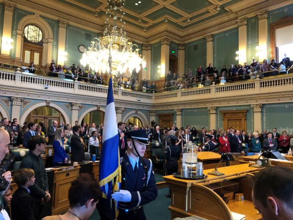 Members of the Mile High Honor Guard present the flags at the opening day of Colorado's legislative session on Wednesday.