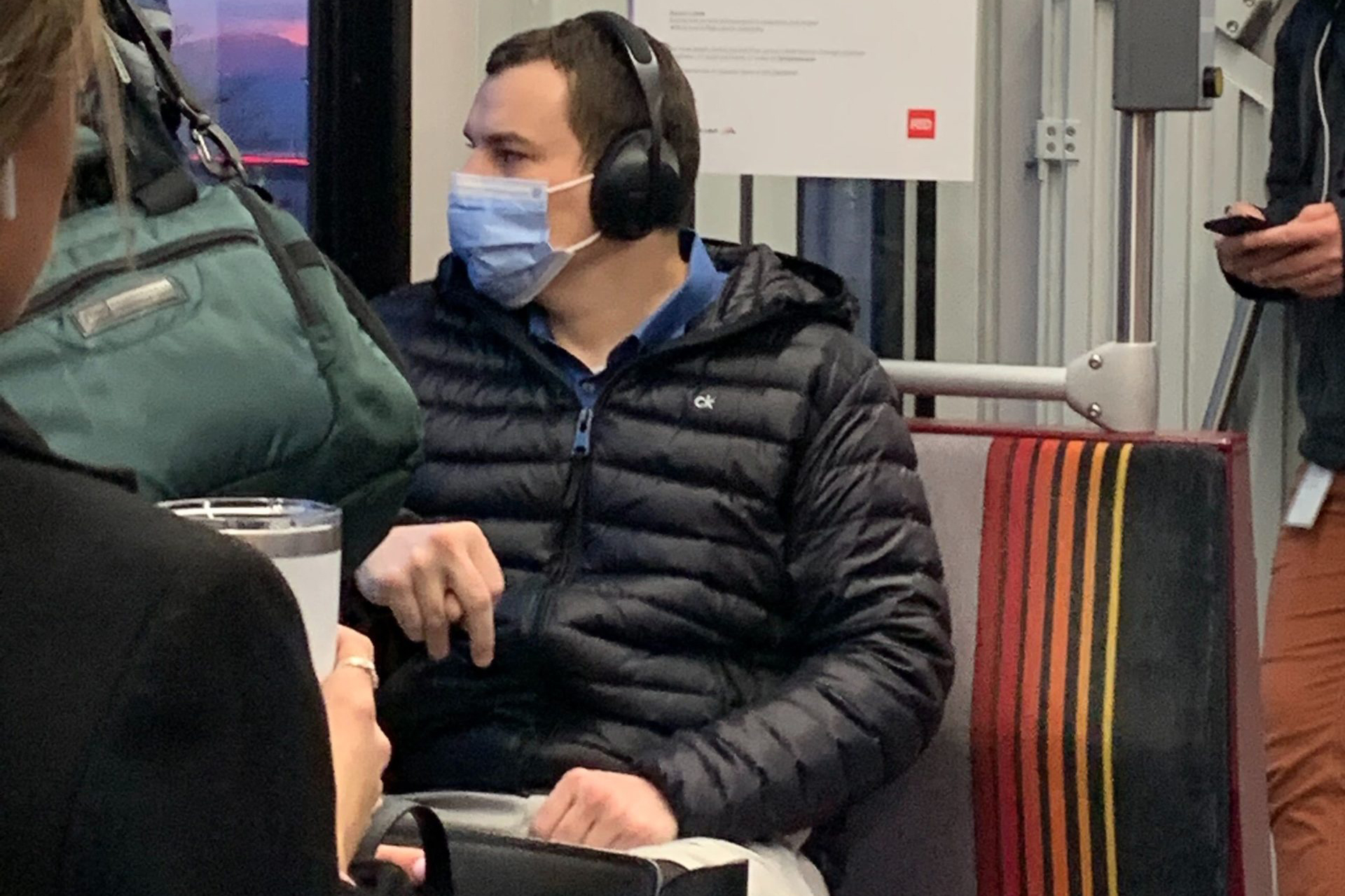 A man wears a health mask while riding RTD's light rail on January 27, 2020. Masks are one way experts say can help stop the spread of viruses.