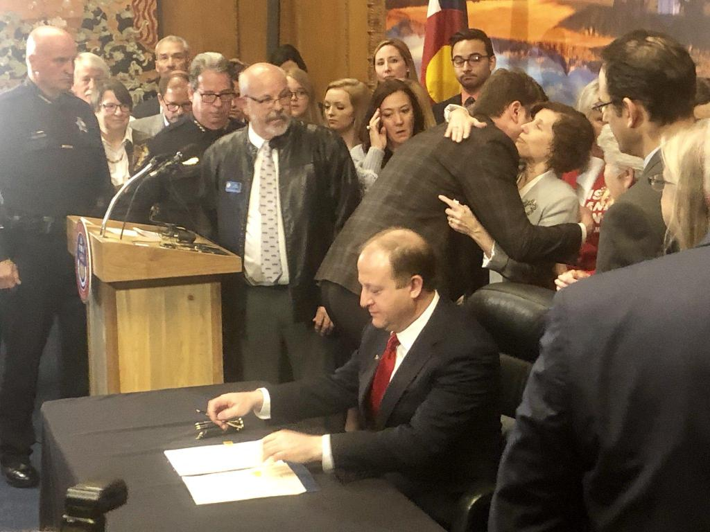 Gov. Polis signs the extreme risk protection order bill into law. File photo.