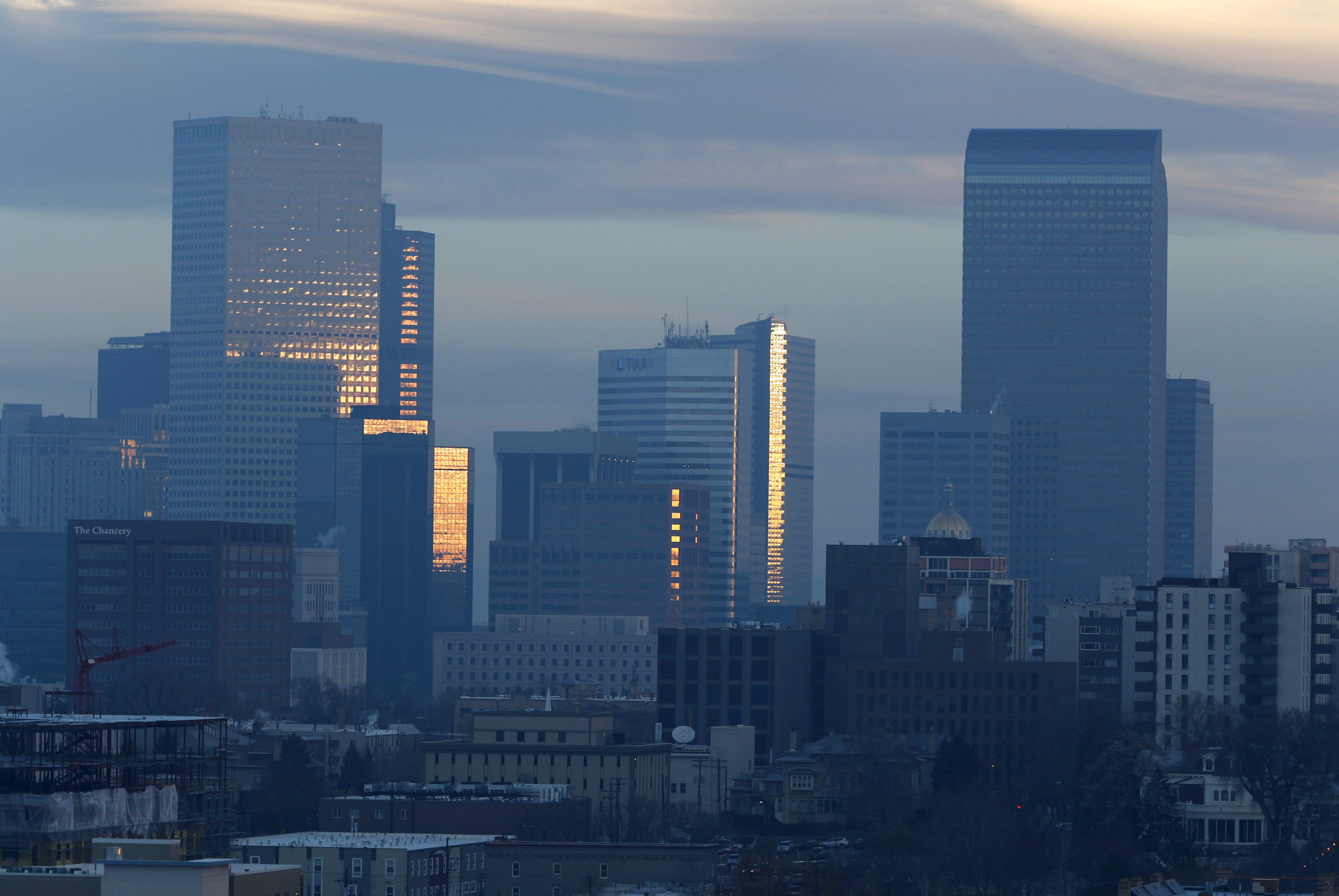 Pollution obscures the skyline of downtown as the sun rises over Denver, Feb. 28, 2019.