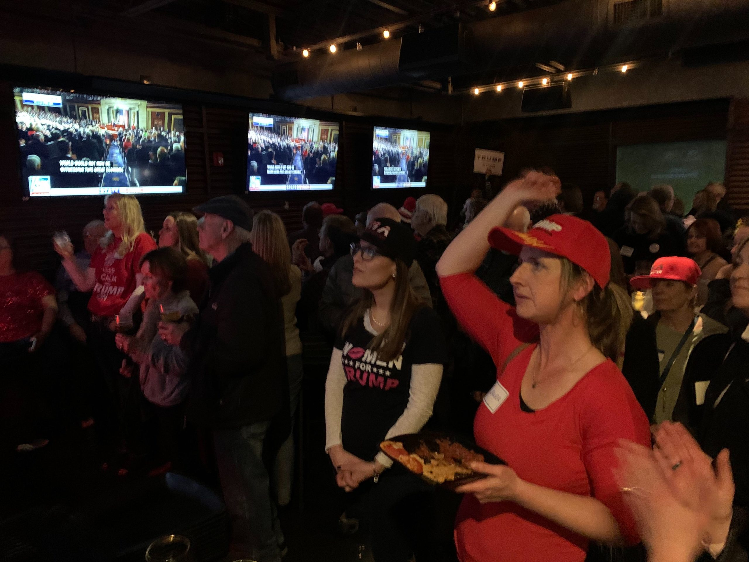 Supporters of President Donald Trump cheered him on during the 2020 State of the Union address on Tuesday, Feb. 4 at The Tavern in Centennial. (Andrew Kenney/CPR News)