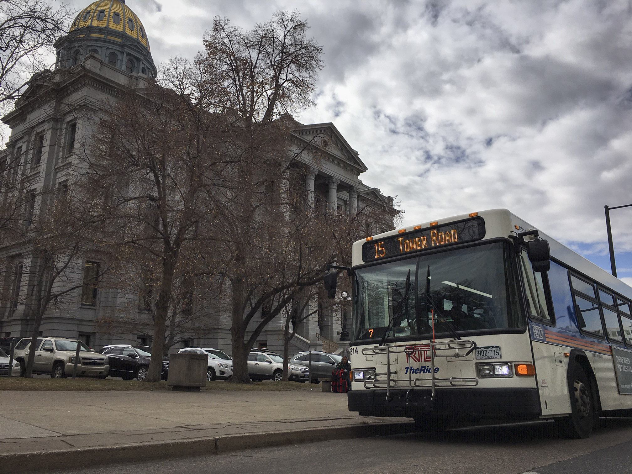 An RTD bus idles outside the state Capitol in January 2020.