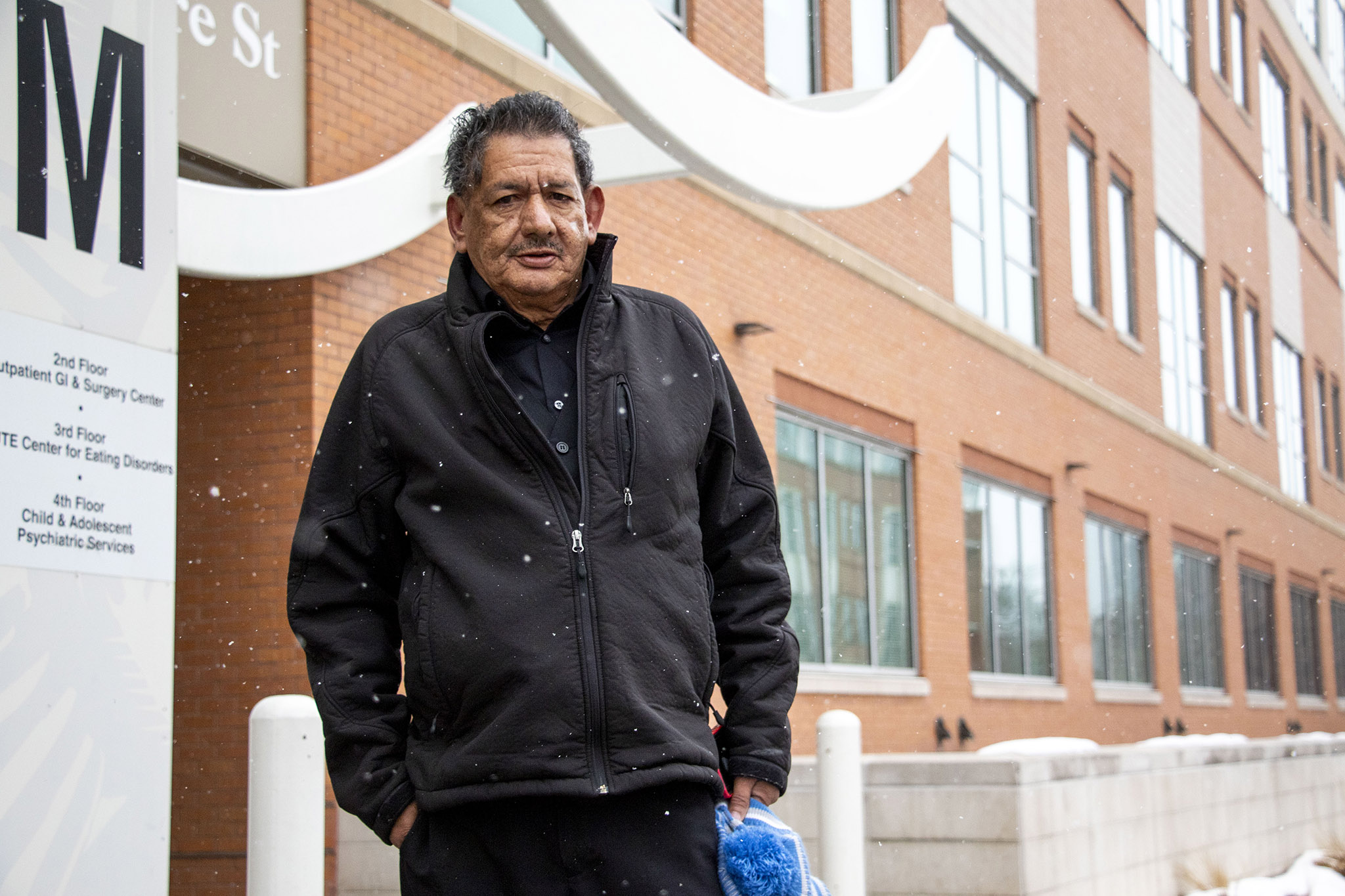 Ricardo Seaeñez Jakuez poses for a portrait outside of the Denver Health building where he's headed for dialysis. Feb. 12, 2020.