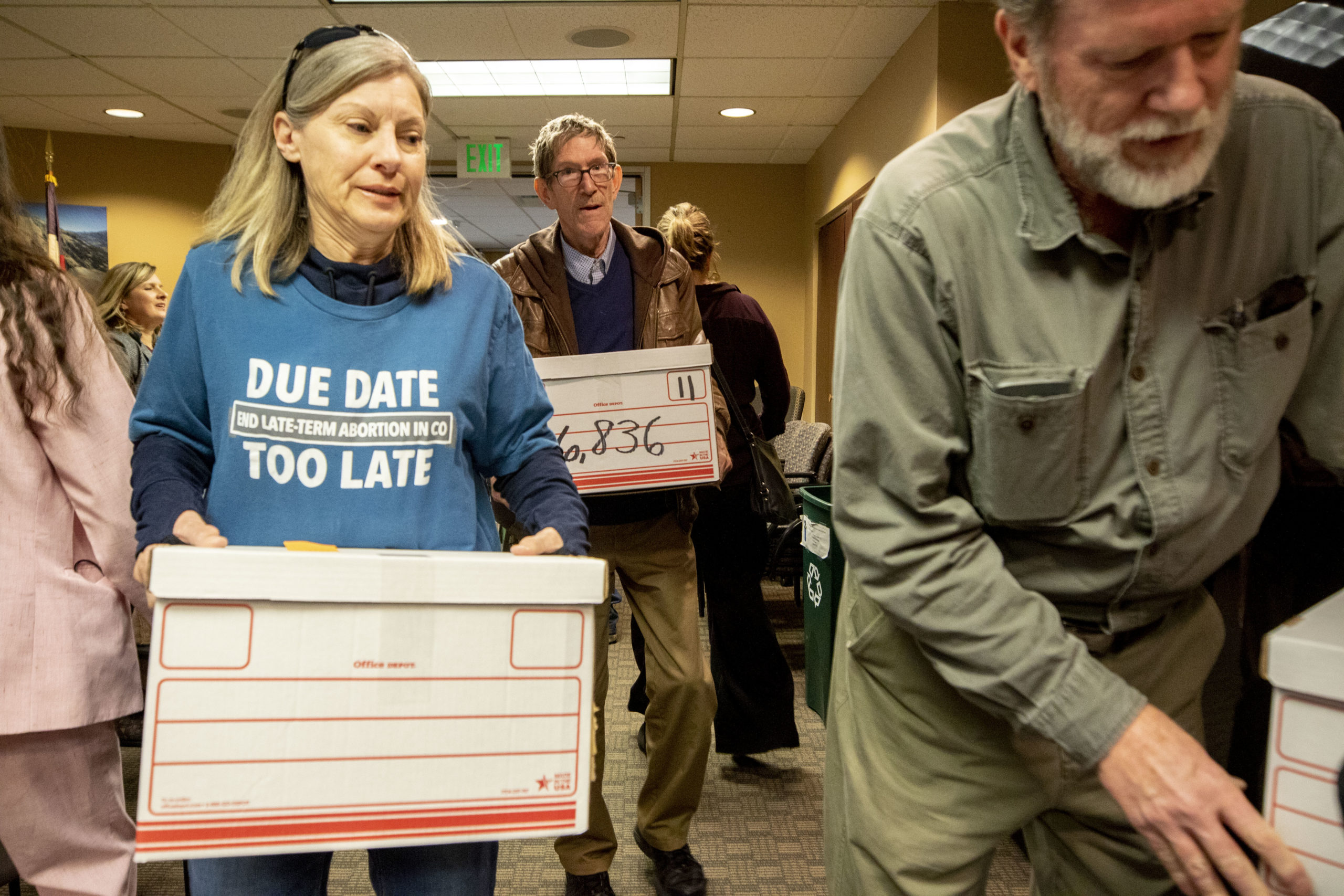 Pro-life advocates deliver thousands of signed petitions to the Colorado Secretary of State's office, initiating a ballot measure process that could ban abortions after 22 weeks of pregnancy. March 4, 2020. (Kevin J. Beaty/Denverite)