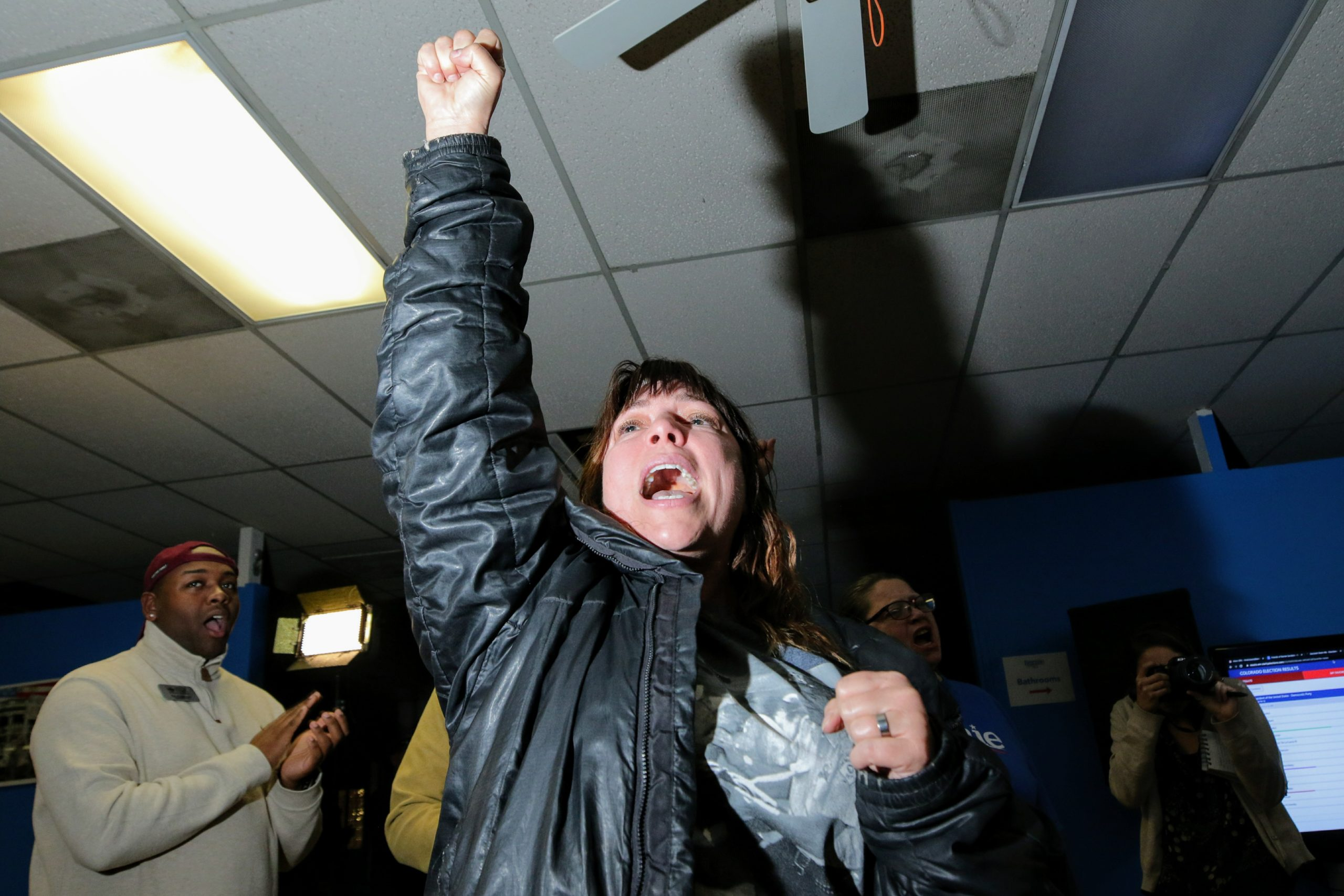 Volunteer RaeLeann Smith at the Bernie Sanders campaign headquarters celebrates as the Vermont Senator is projected to win Colorado.
