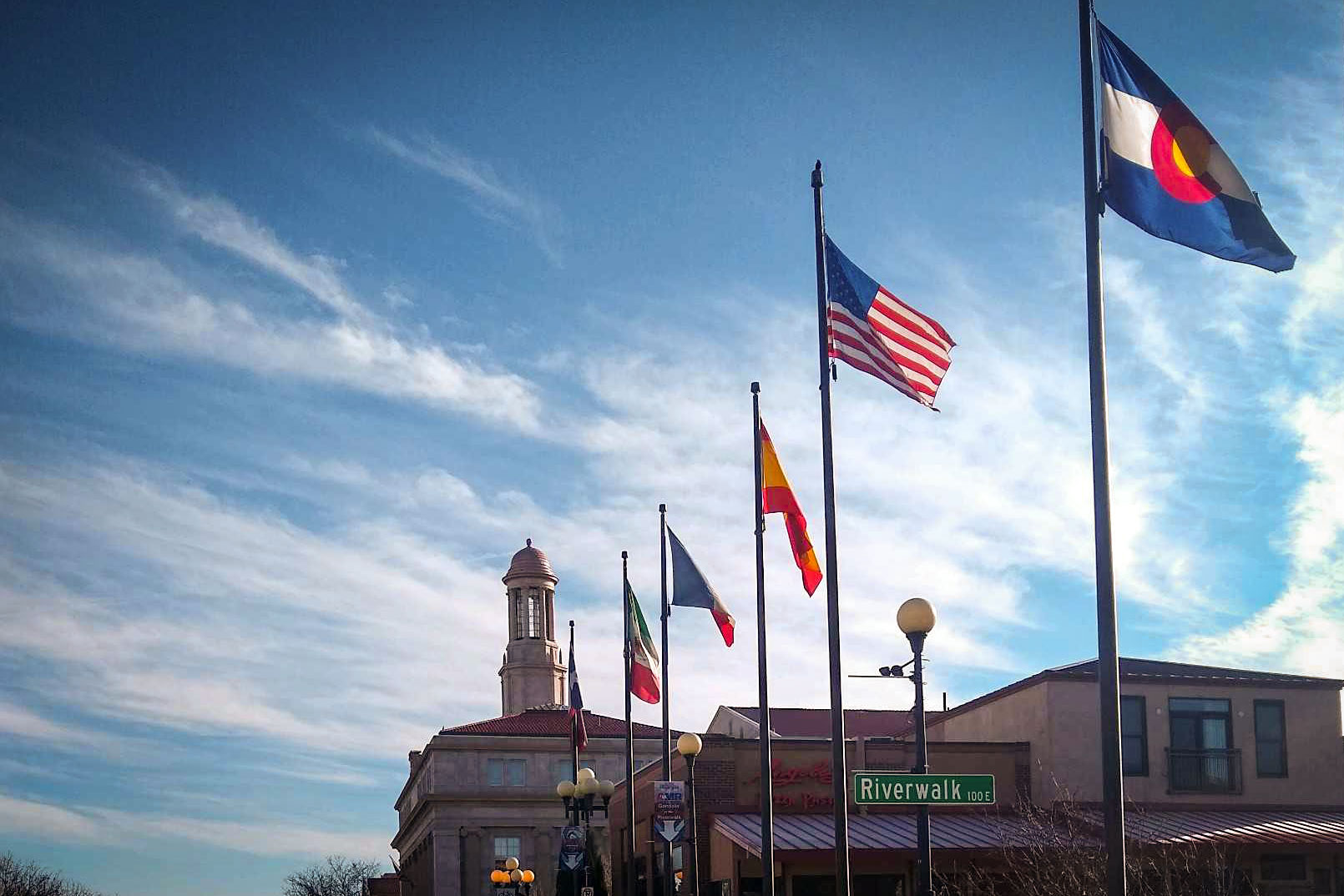 Some of the flags — five of which also adorn the city seal — that fly along the Union Avenue Bridge that crosses over the Historic Arkansas Riverwalk, March 16, 2020.