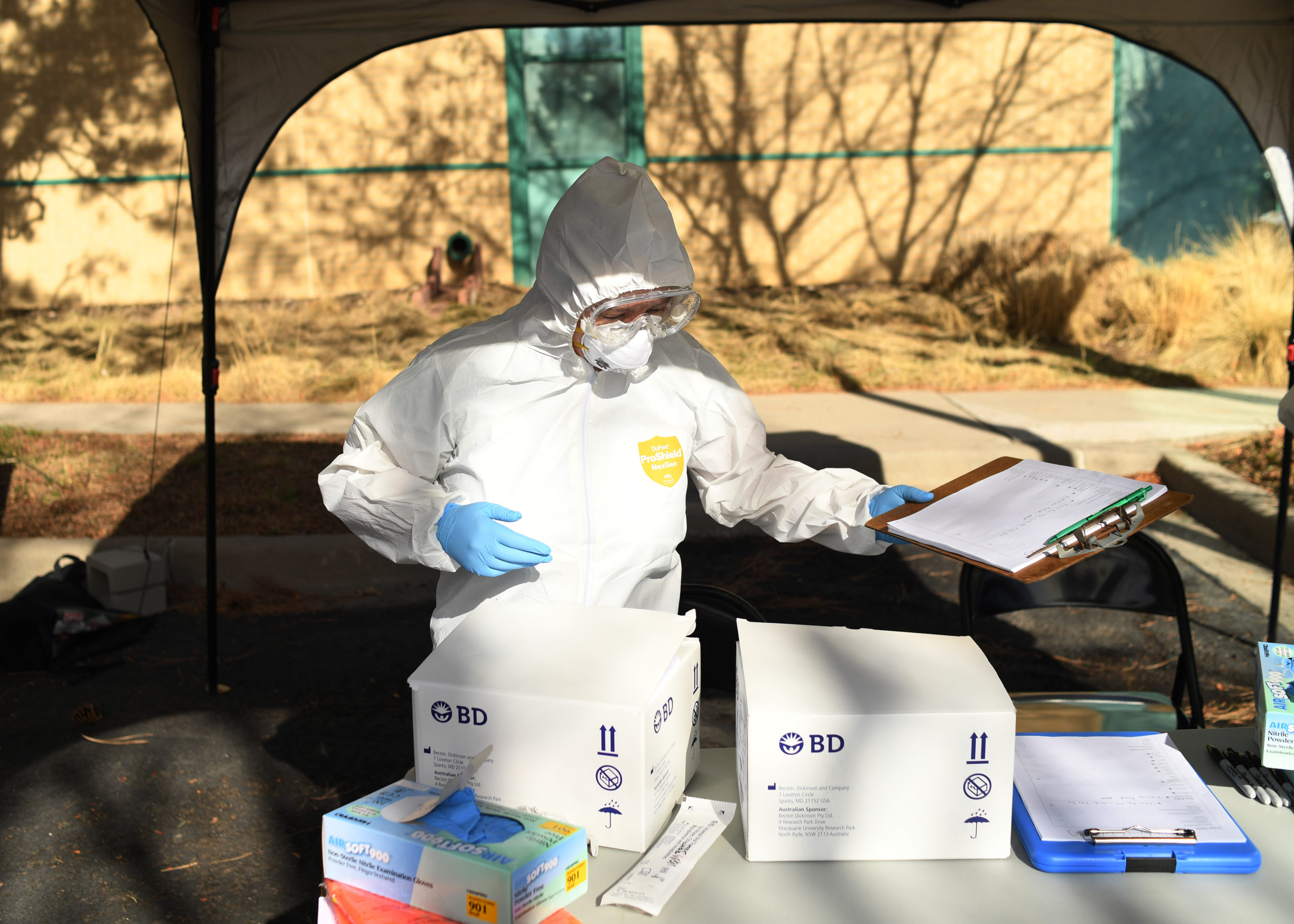A woman sets up for the Colorado Department of Public Health and Environment first community testing center for COVID-19 at the state lab on March 11, 2020 in Denver, Colorado. The drive-up testing center at 8100 E. Lowry Blvd, was open from 10 a.m. - 2 p.m for patients with doctorÕs order.