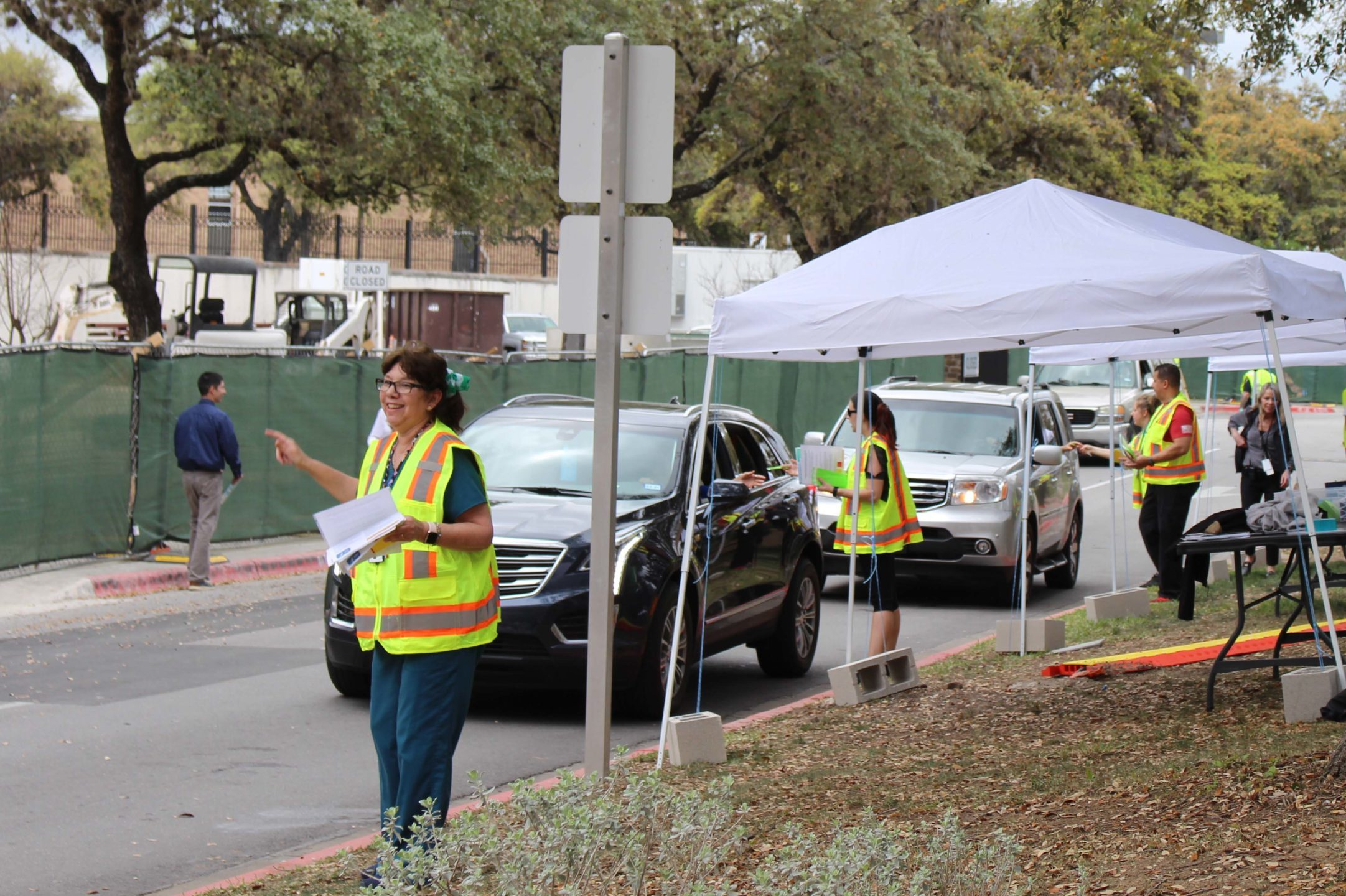 VA staff and volunteers screen patients, employees, and visitors at the entrance to the Audie Murphy Memorial VA Hospital in San Antonio.