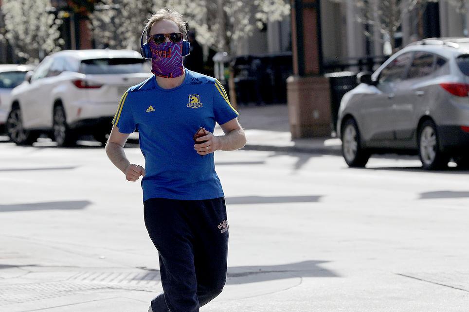 Runner Wearing Mask In LoDo
