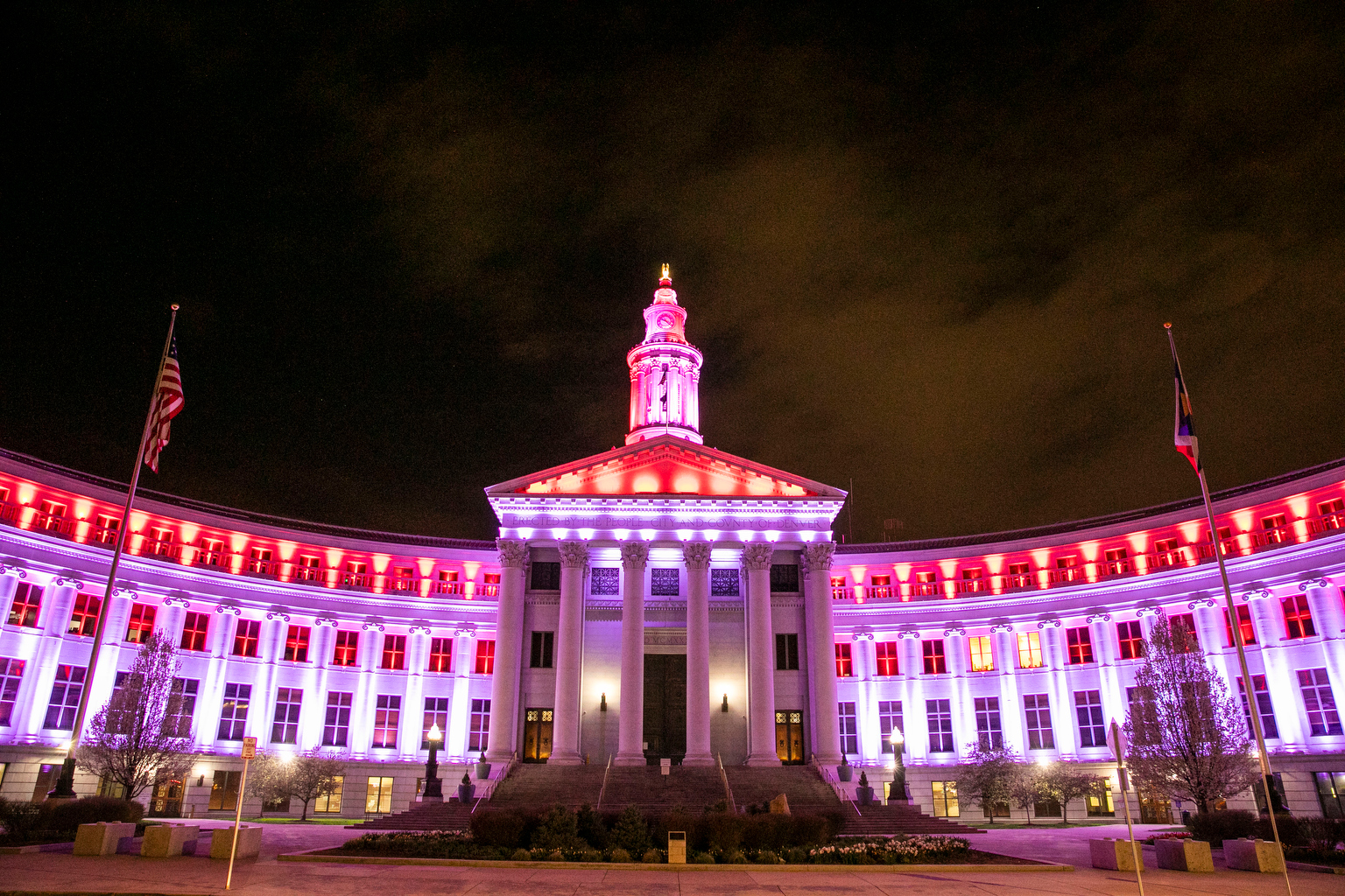 Denver City and County Building lit in red and white first responders coronavirus