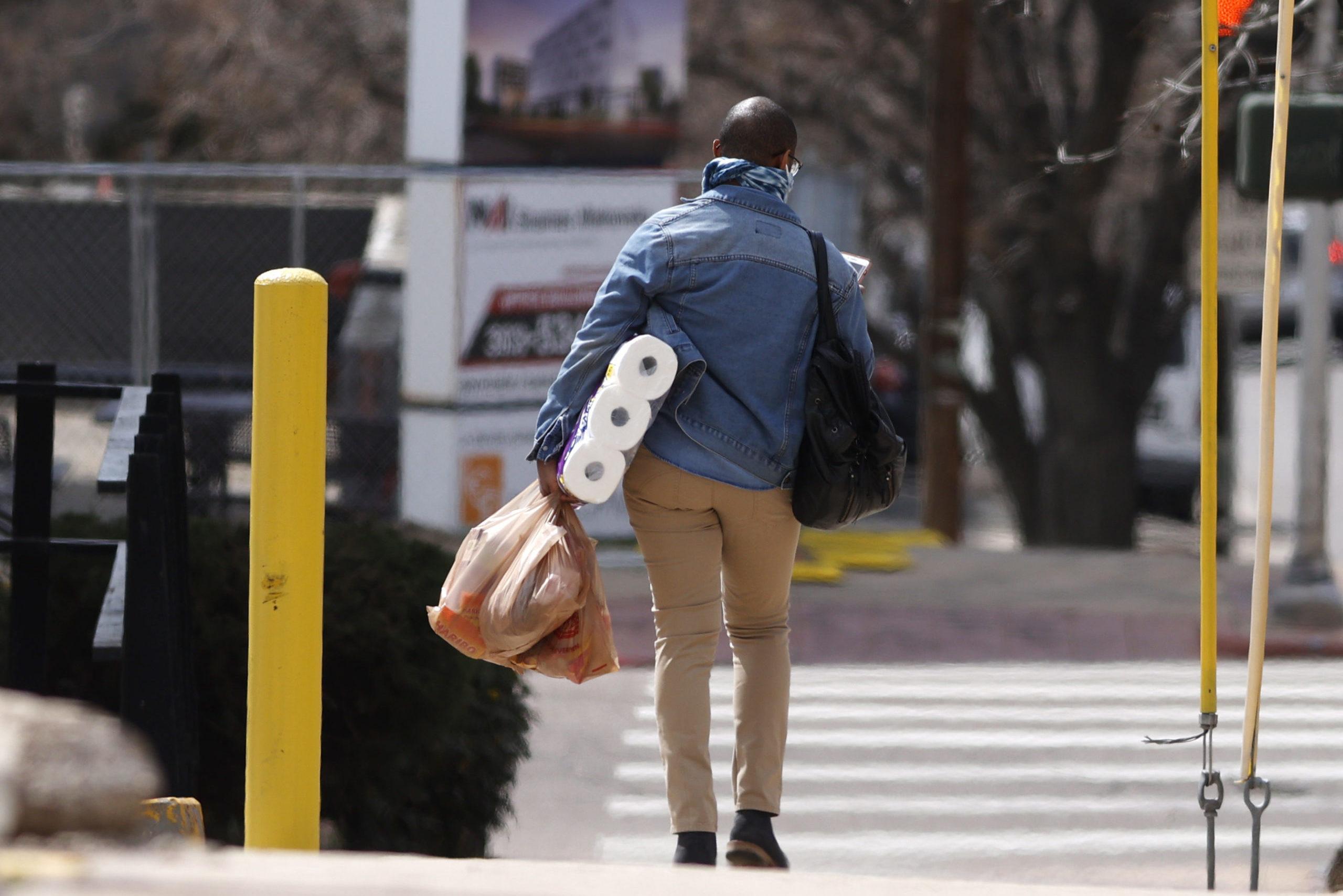 shopper with toilet paper, r m