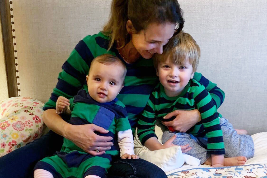 """Beatriz Lynch spends extra with her two toddlers, Beatriz """"Bibi"""" (right) and Agustin (left) after she closed her law office because of the need for social distancing."""