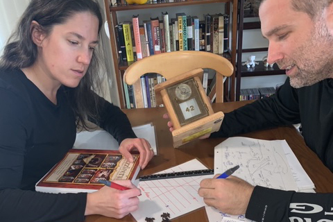 Elyssa and James Warner plot out a new puzzle for Paruzal customers (or maybe themselves).