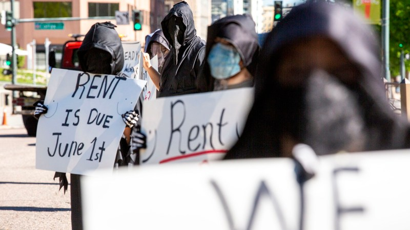 Denver Democratic Socialists, dressed as grim reapers, protest a lack of eviction protections in front of the Capitol. May 26, 2020.