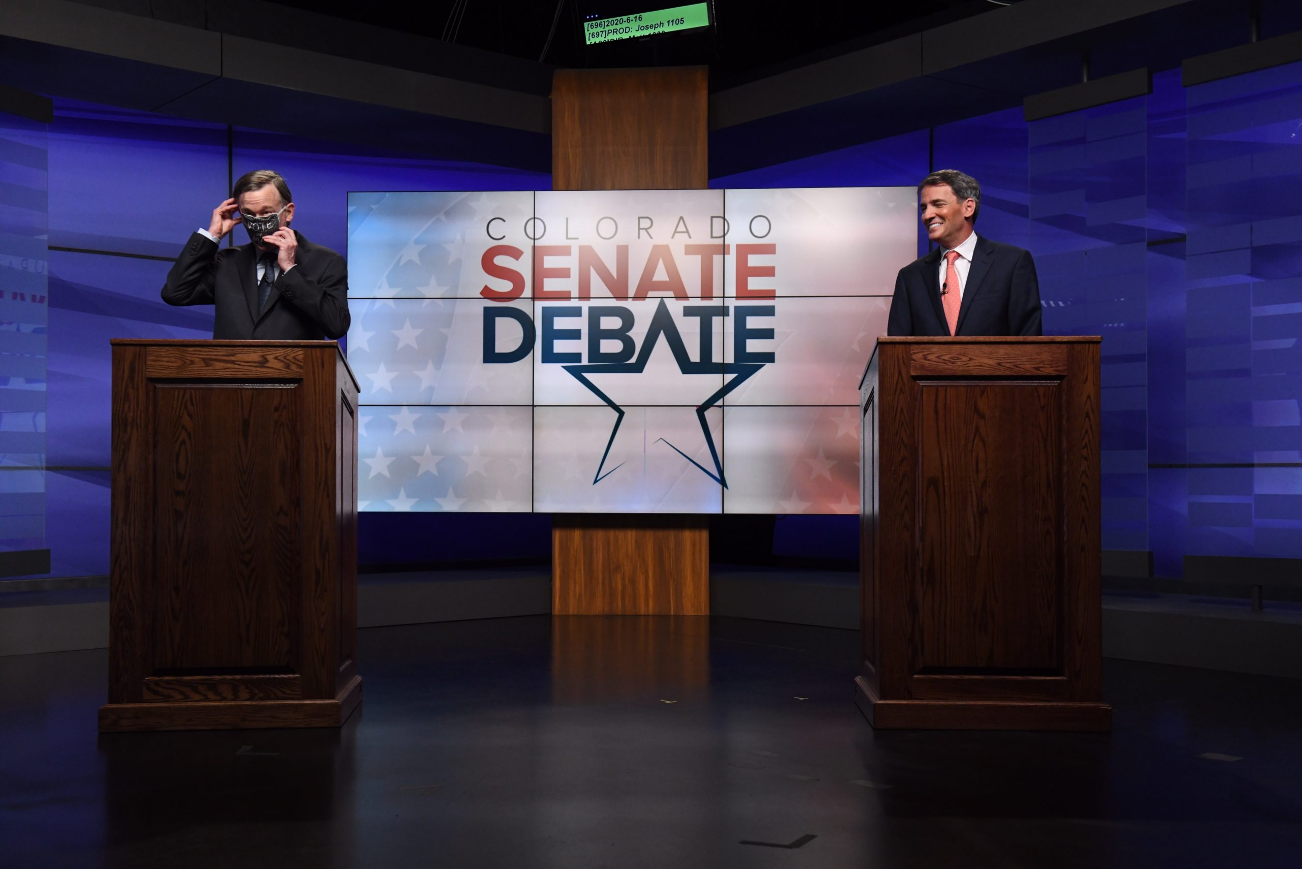 Former Colorado Gov. John Hickenlooper, left, puts on a mask after finishing a debate against former state House speaker Andrew Romanoff in the studio of Denver7 in Denver on Tuesday, June 16, 2020. The debate, held ahead of the Democratic primary, was sponsored by The Denver Post, Colorado Public Radio News, Denver7 and the University of Denver Center on American Politics. The winner of the June 30 primary will go on to face incumbent Republican Colorado Sen. Cory Gardner in November's general election.