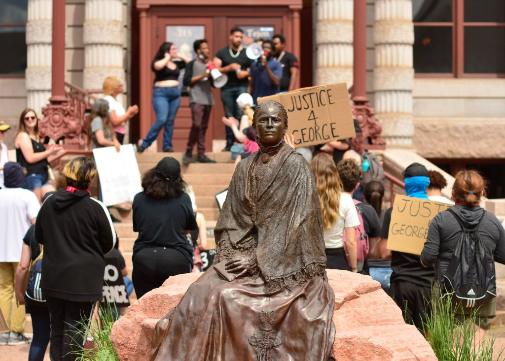A statue of Susan B. Anthony gazes towards Pikes Peak, America's Mountain as protesters and activists peacefully protest the death of George Floyd in downtown Colorado Springs, CO on June 2, 2020.