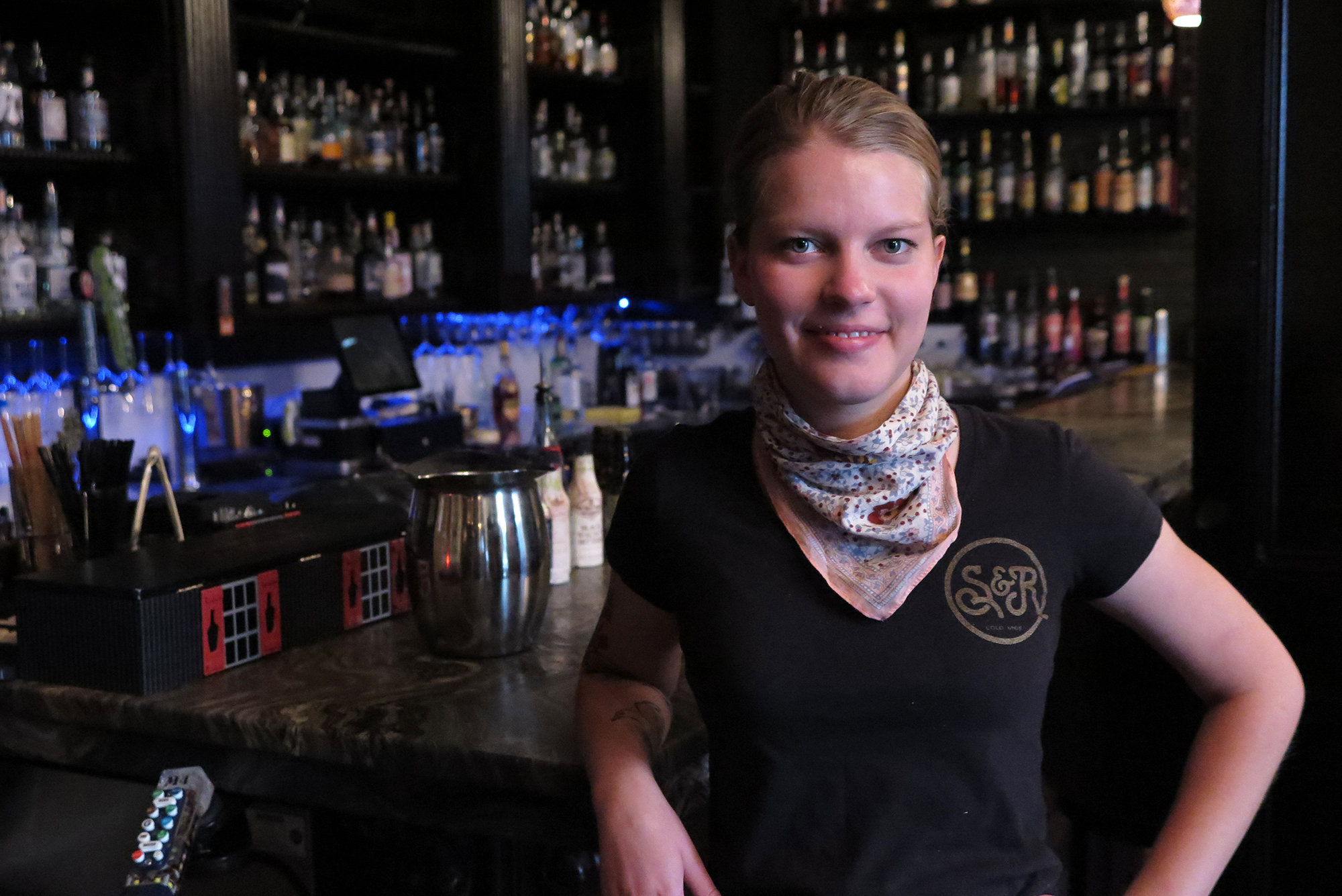 Clothing boutique owner Rebecca Moon is working two days a week at the Colorado Springs bar Shame and Regret to make ends meet.