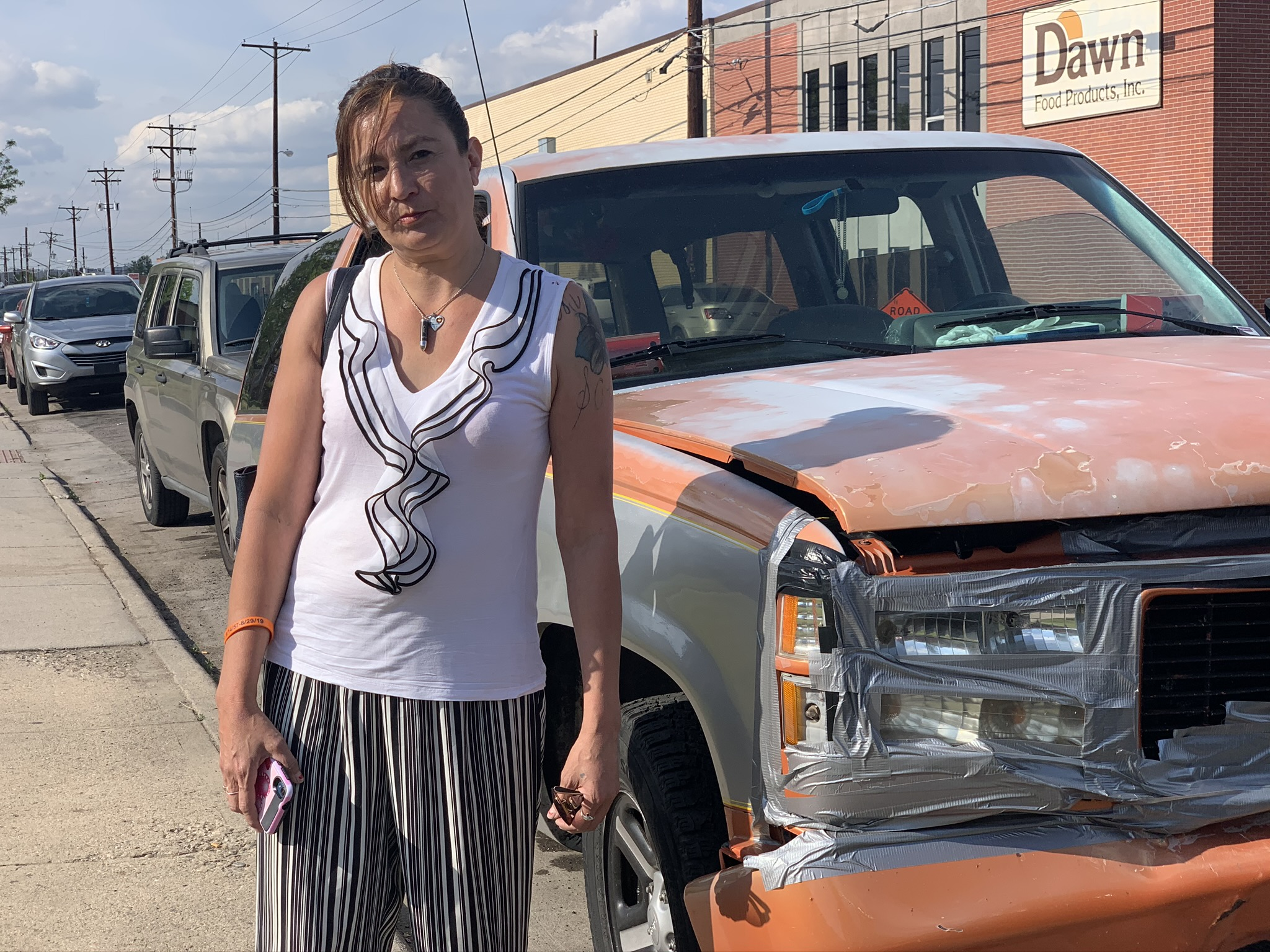 Tiffany Quintana poses for a photo on May 28 in the Sunnyside neighborhood of Denver, near the vehicle where she lived for several weeks. (Andrew Kenney/CPR News)