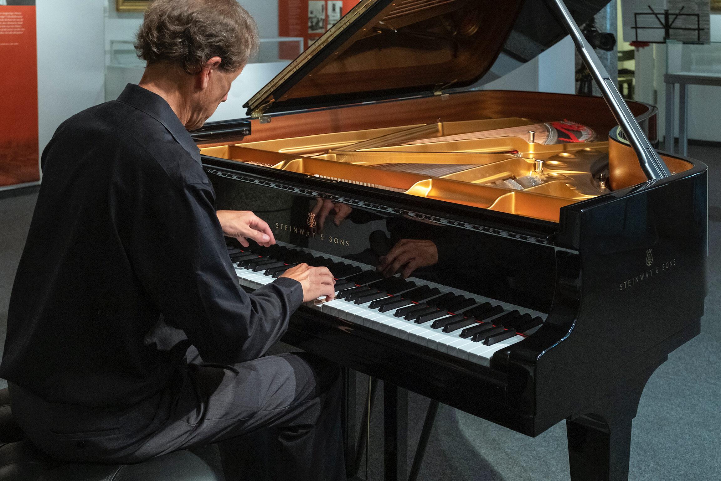 Dr. David Korevaar playing a Steinway concert grand.