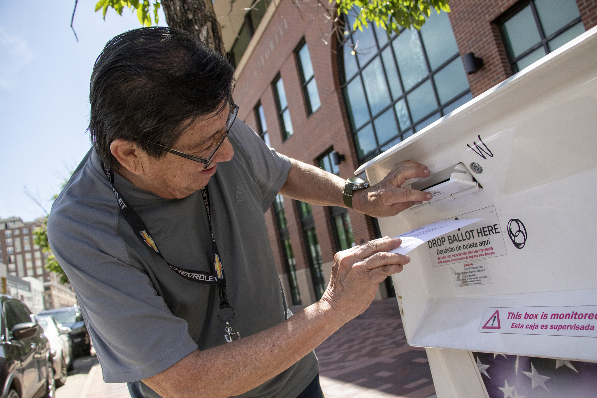 Kenny Borrego casts his ballot outside of the Blair-Caldwell African American Research Library on Welton Street. Five Points, June 4, 2019.