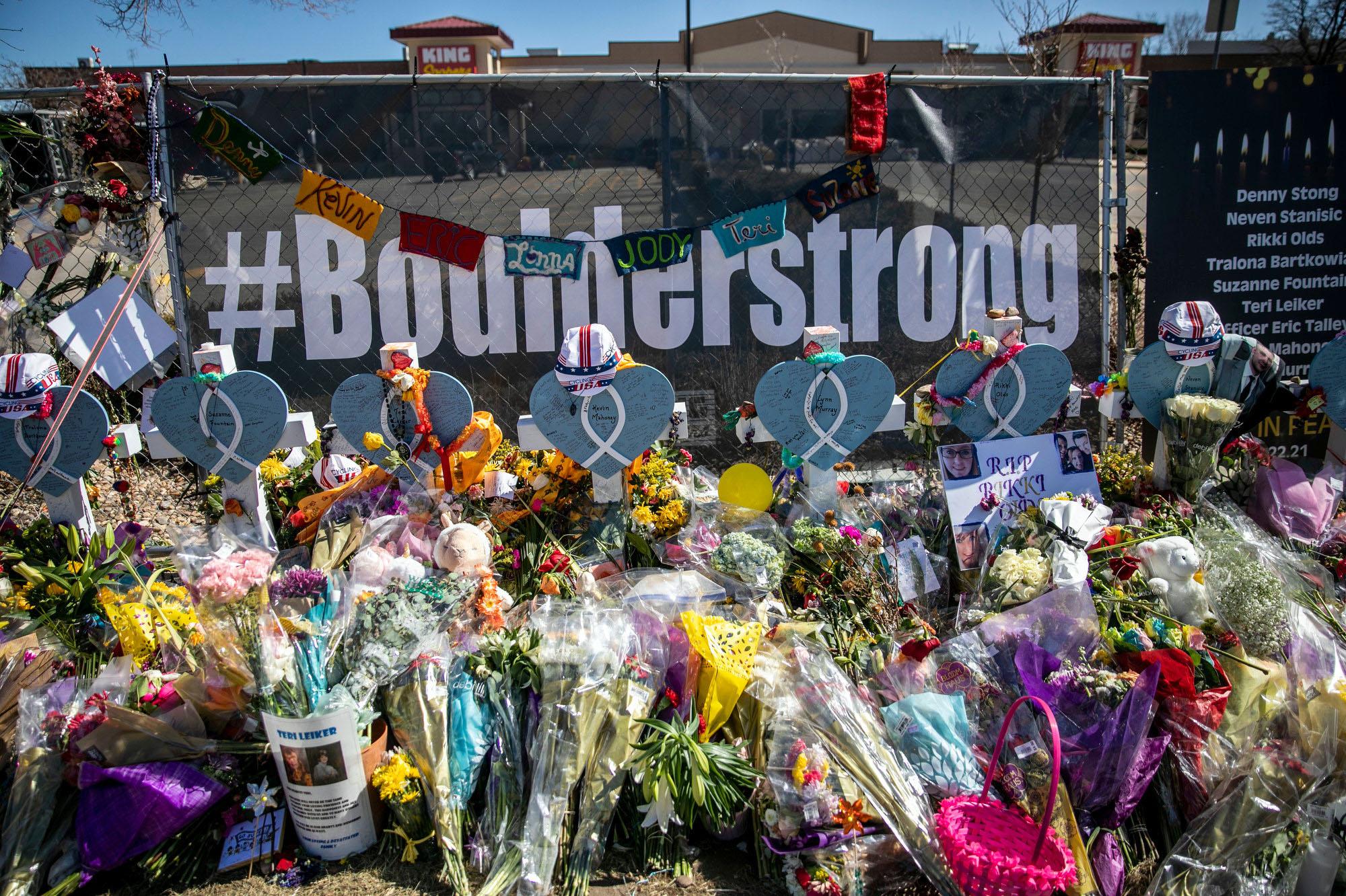 210329-BOULDER-SHOOTING-MEMORIAL-FLOWERS-SIGNS