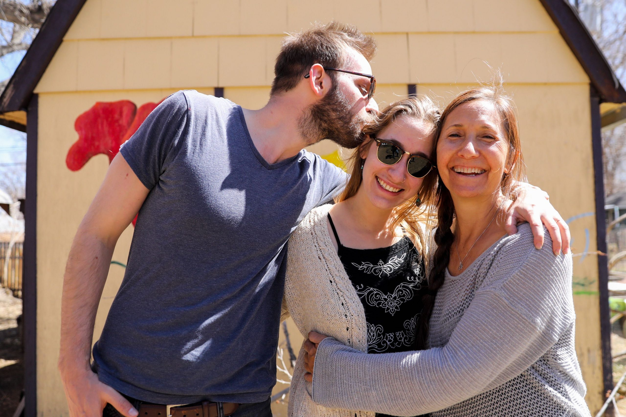 Hanna Bull (center) with her husband Raviv Bull and her mother Ramya Bruskin in the backyard of Ramya's home in Longmont on Monday, March 30, 2021.