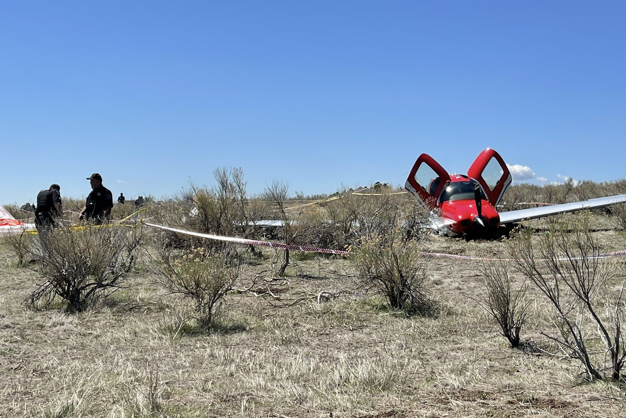 First responders investigating the scene after two small planes collided in mid-air over Cherry Creek State Park.