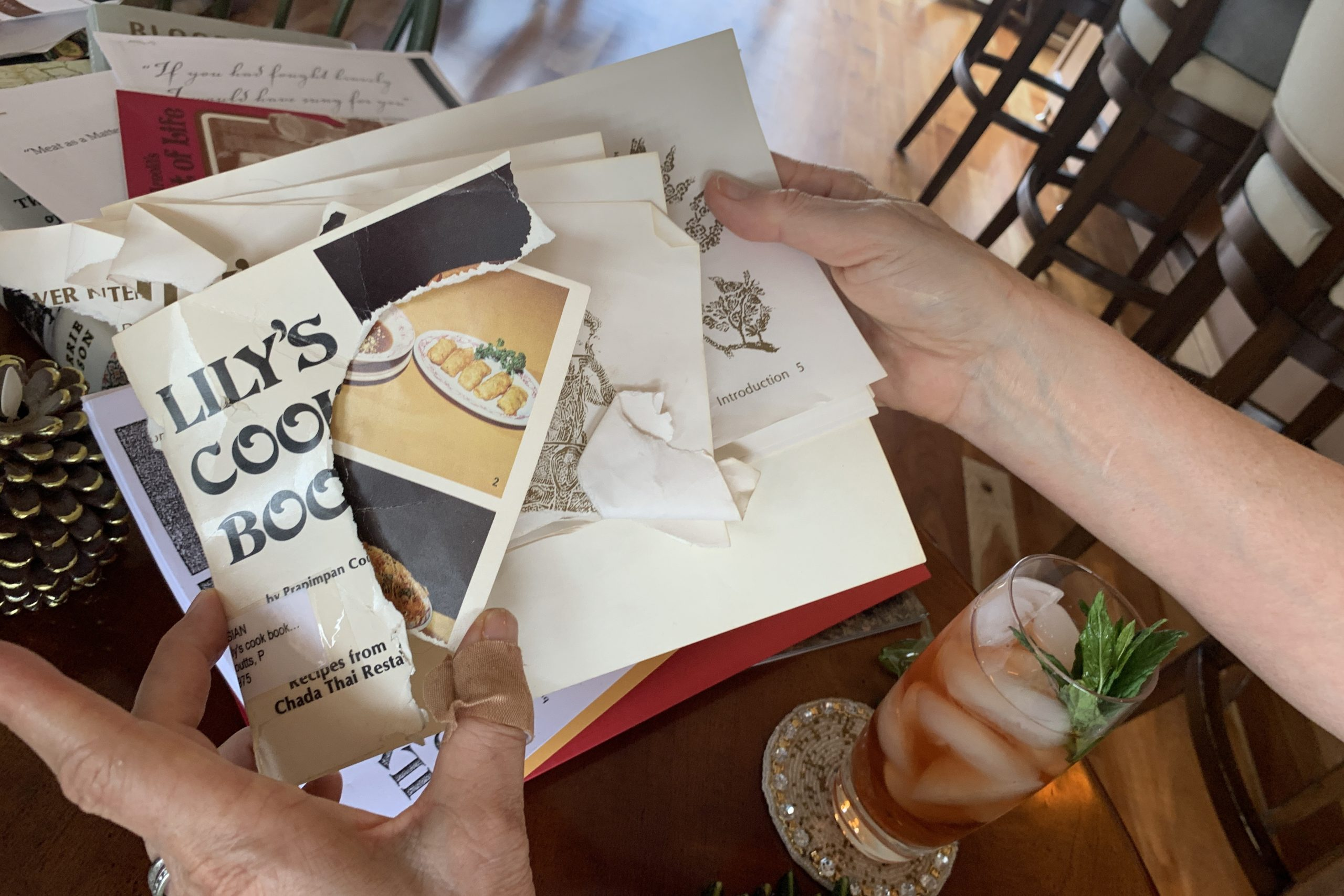 """Holly Arnold Kinney's copy of """"Lily's Cookbook,"""" a collection of the restaurant's most popular recipes. The book had a run-in with Kinney's dog."""