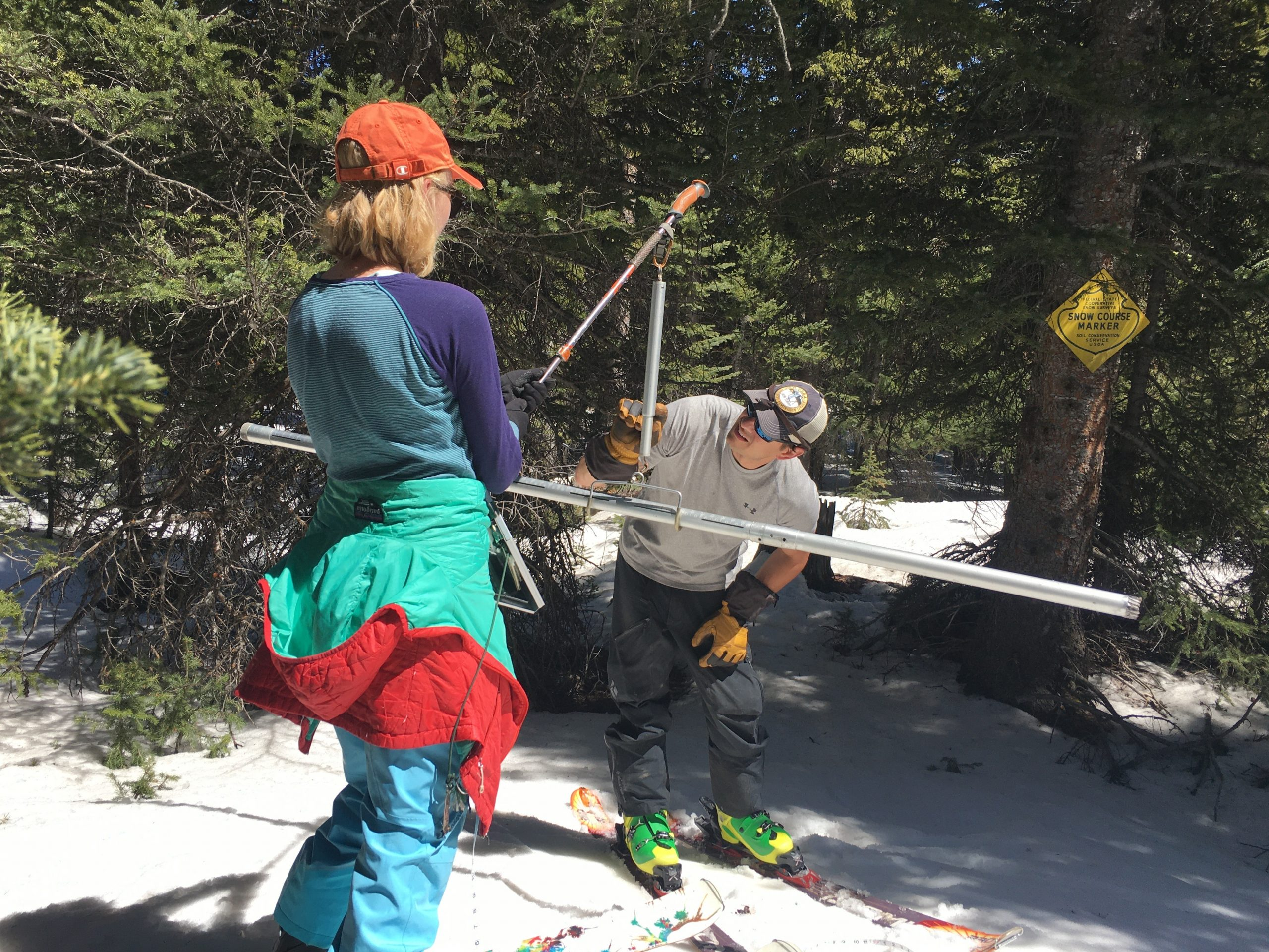 Colorado Snow Survey supervisor Brian Domonkos and NRCS civil engineer Madison Gutekunst weigh the snow to know how much moisture it holds on April 30, 2021.