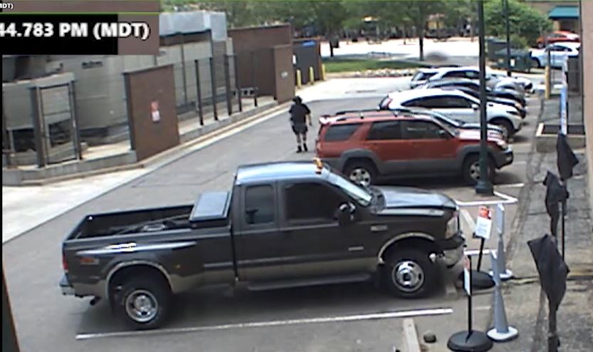 A screengrab from a video released by Arvada Police shows alleged shooter Ronald Troyke walking back to his truck after shooting Officer Gordon Beesley.