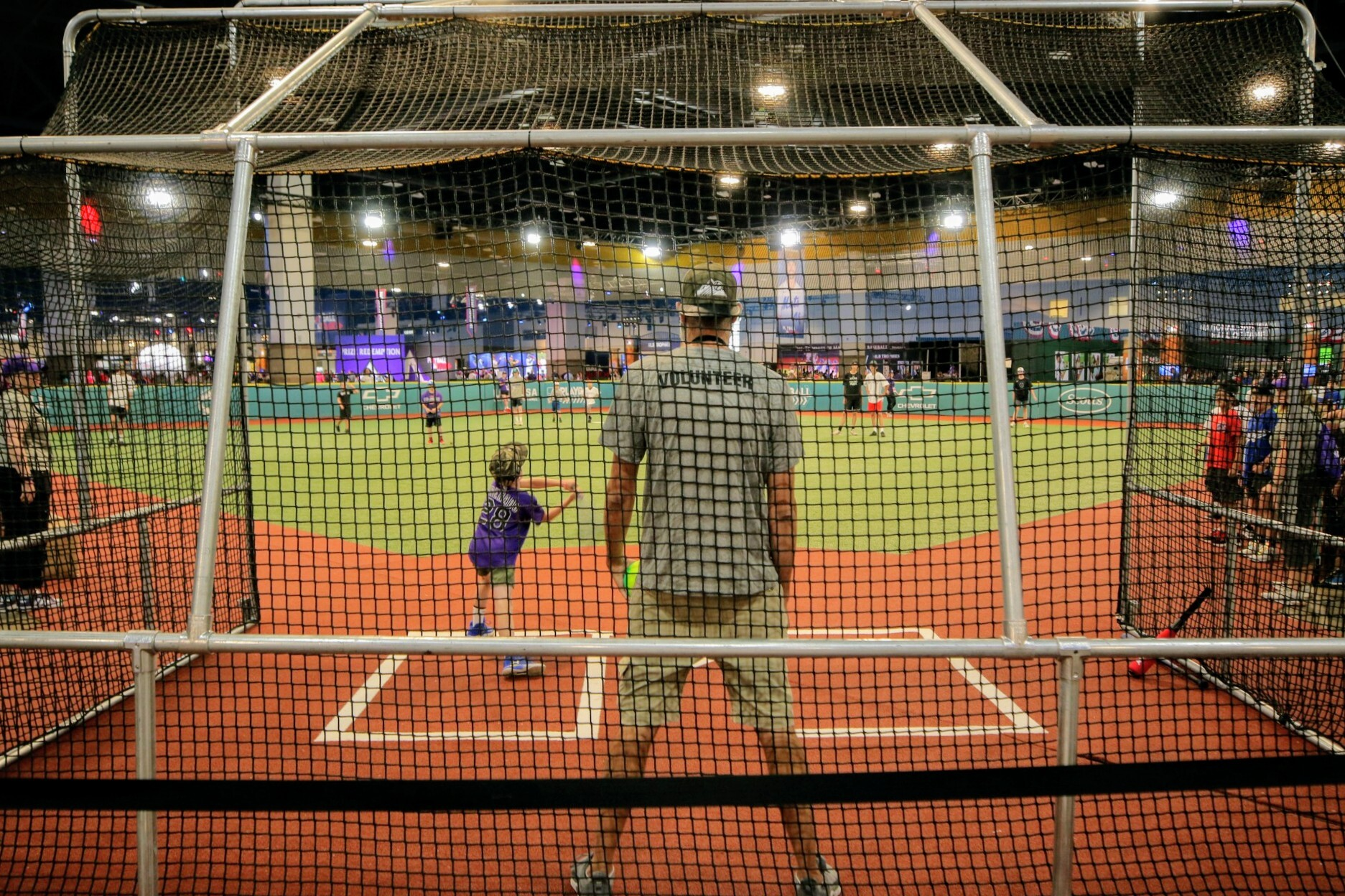 Kids play at the MLB Play Ball Park at the Colorado Convention Center in Denver on Tuesday, July 13, 2021.