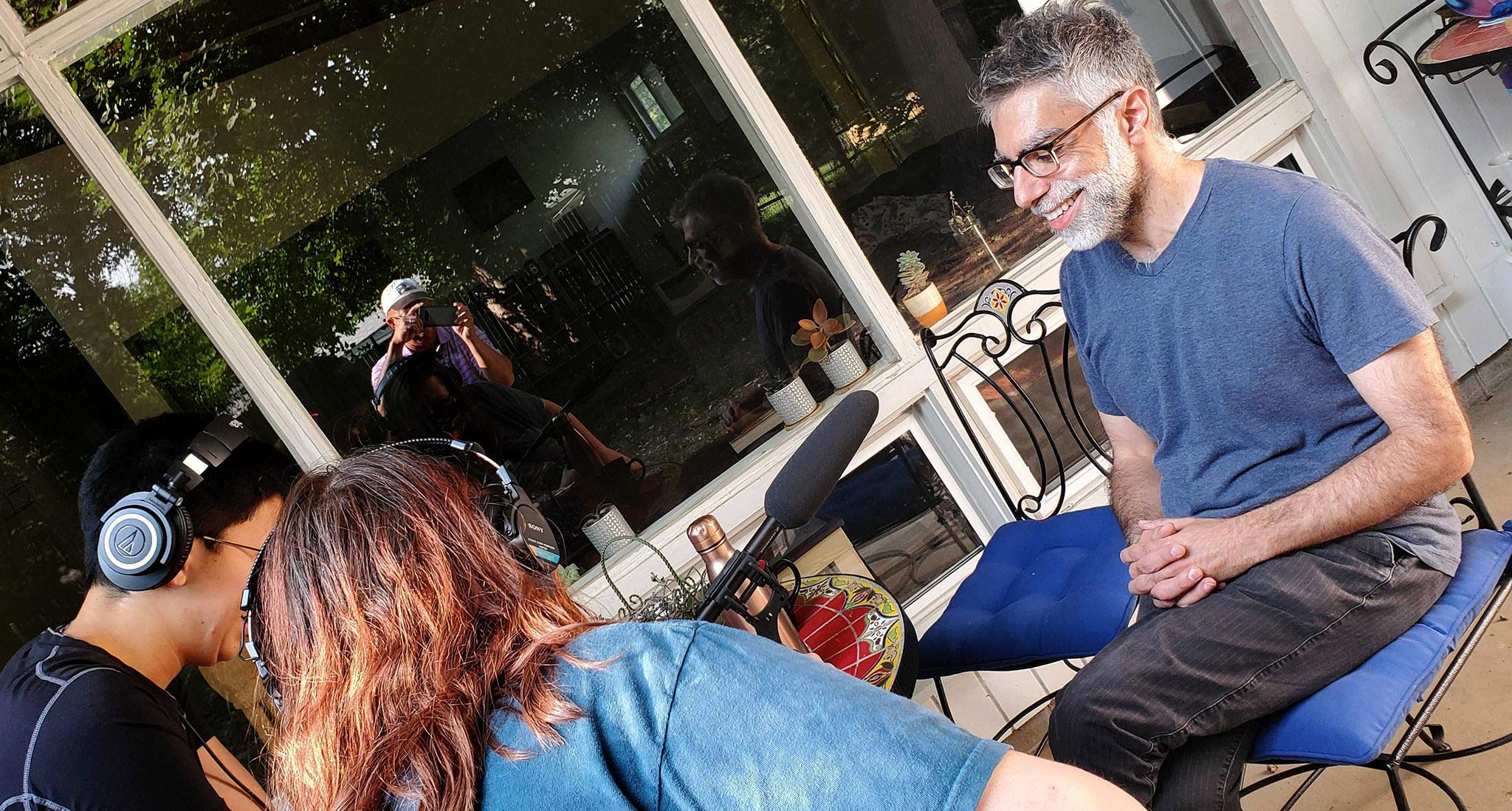 Next Generation Radio participant Ivy Winfrey interviews Filmmaker Usama Alshaibi at his home in Boulder.