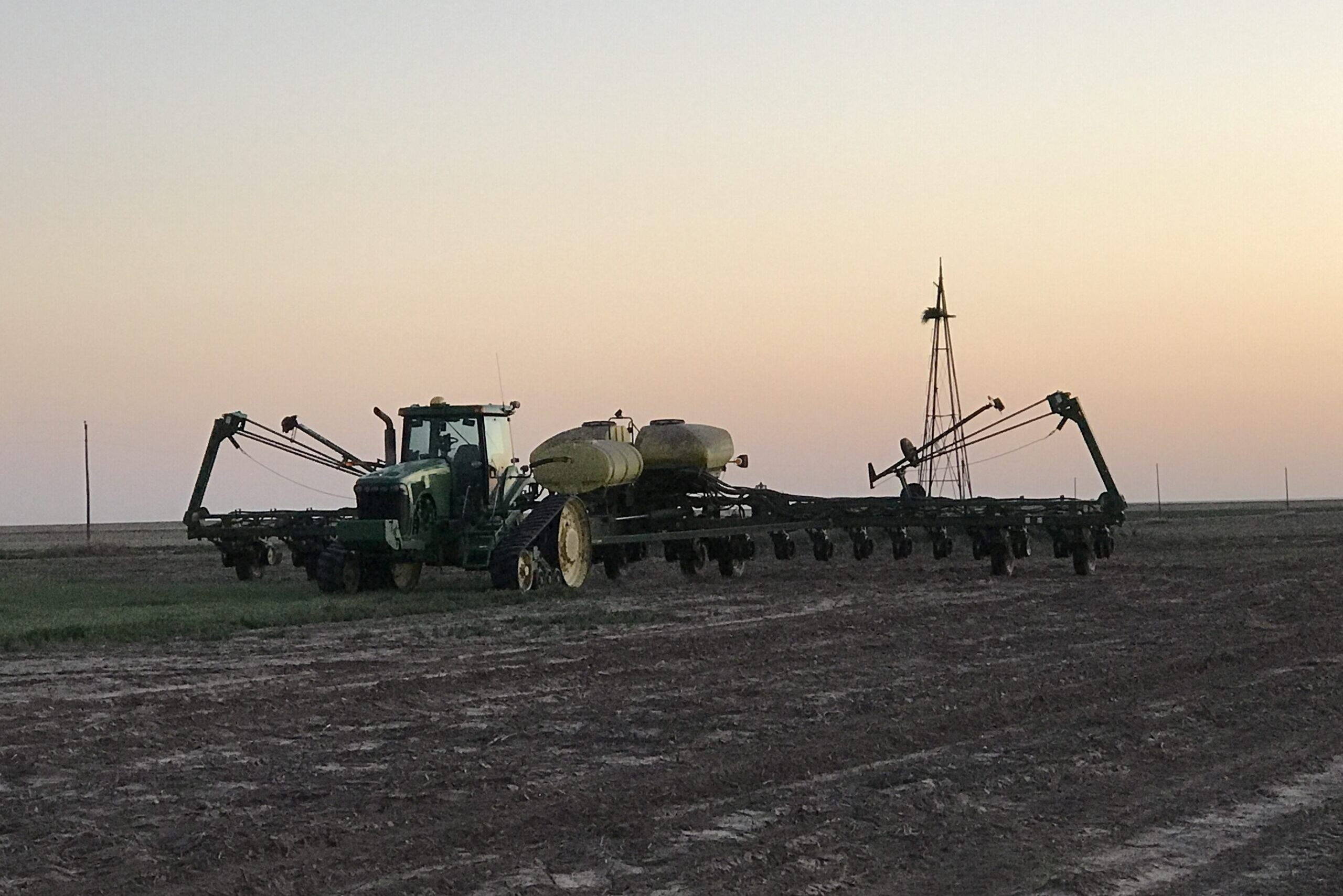 A planter hard at work planting sunflower seeds at dusk on Colorado's Eastern Plains.