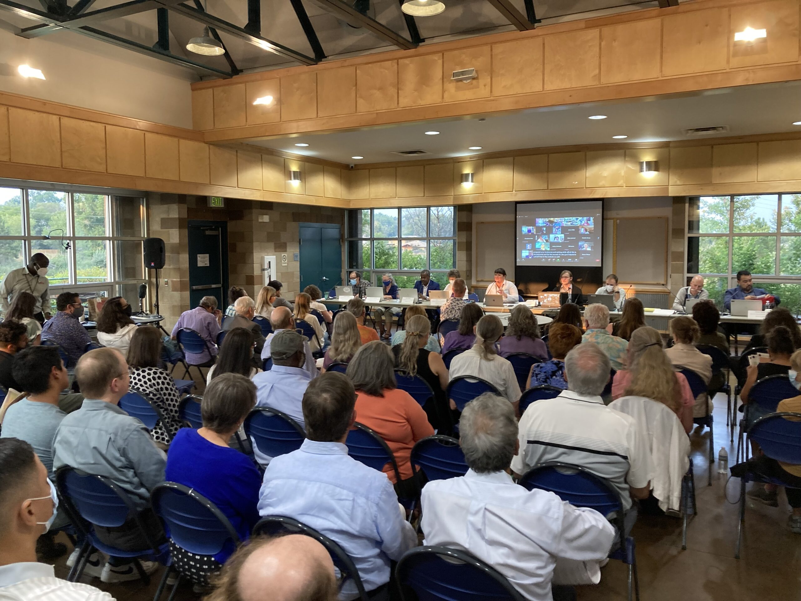 It's a packed room at a joint Colorado Independent Redistricting Commissions public hearing in Longmont, CO, on August 10, 2021.