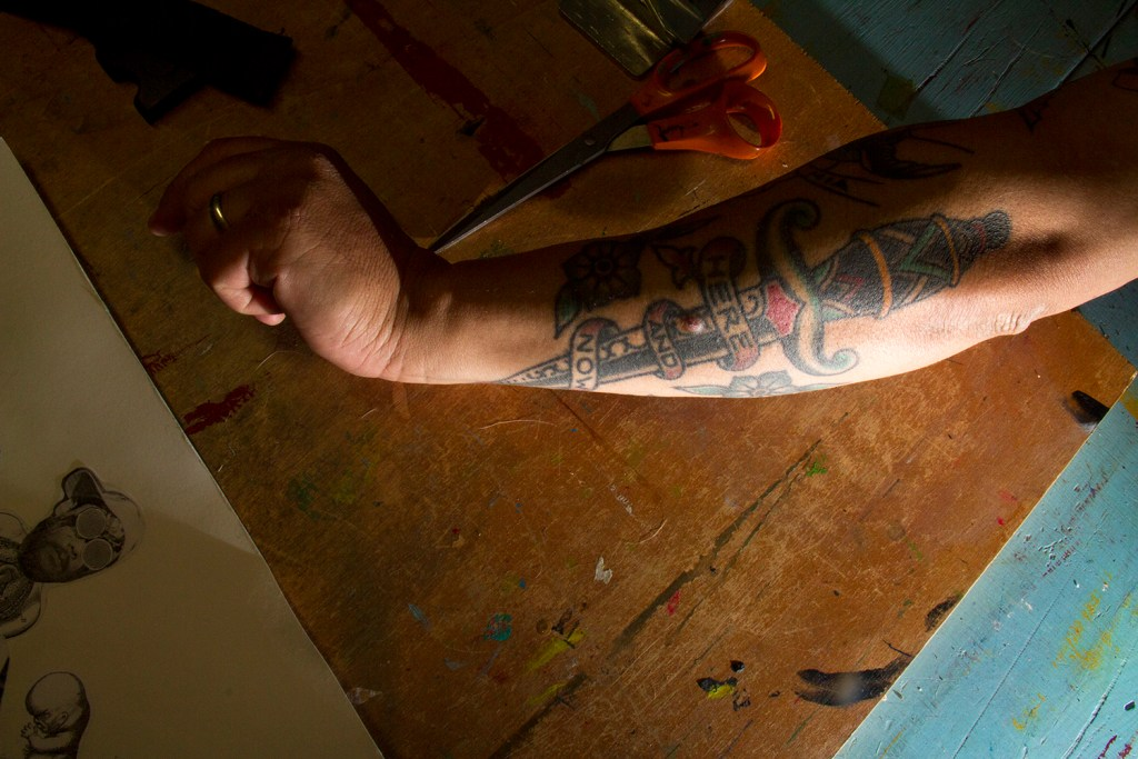 "John Johnston's arm, which reads, ""Here and now."" (Kevin J. Beaty/Denverite)  denver; denverite; colorado; art; nirvana; kurt cobain"