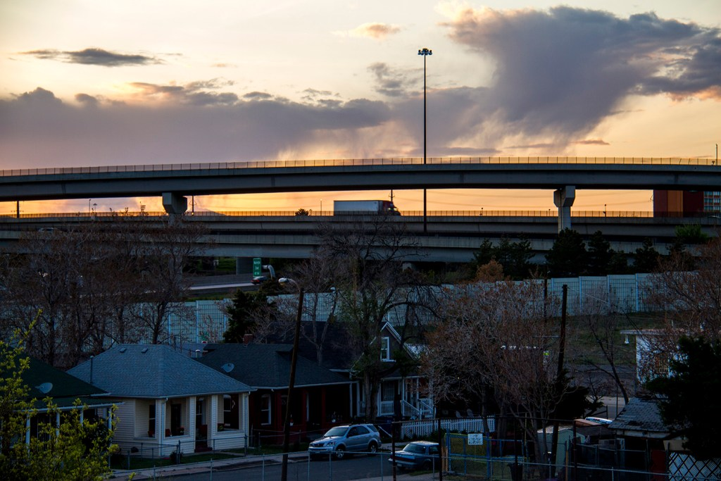 A truck drives over residential Globeville, which is surrounded on all sides by major roadways. (Kevin J. Beaty/Denverite)