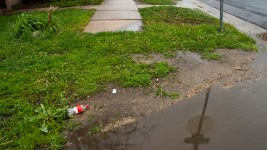 Though a good part of Elyria-Swansea had accommodable sidewalks, a lack of infrastructure and upkeep is evident as well as cause for local groups to begin engaging city council.  corridor of opportunity; eyria; swansea; infrastructure; globeville; development; sidewalks; puddles; rain; denver; colorado; denverite; kevinjbeaty