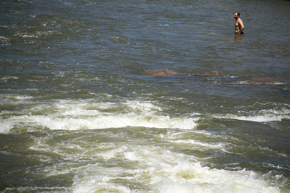 A man stands in the South Platte River at Confluence Park. (Kevin J. Beaty/Denverite)  confluence park; platte river; kayak; sports; recreation; denver; denverite; colorado; kevinjbeaty