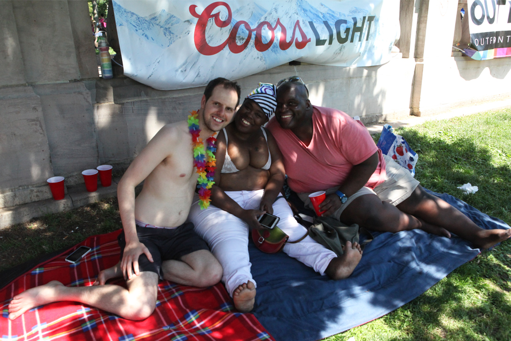 """Friends since college, Crystal, Matthew and Nathan take a break from the sun. """"Denver may not be a gay mecca per say, but it has a live and let live attitude,"""" Nathan said. """"There's a level of respect here you don't see other places."""" (Chloe Aiello/Denverite)"""