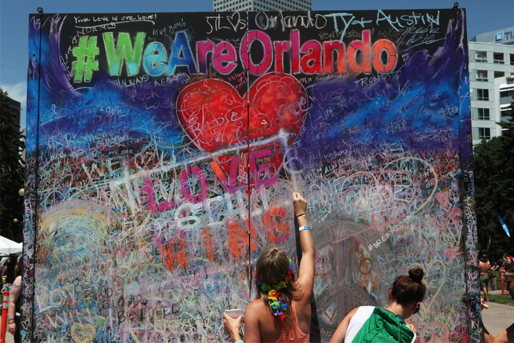 Denver Pride Fest 2016 paid tribute to Orlando victims, most strikingly through this chalk wall. Participants were invited to write supportive messages in rainbow chalk. (Chloe Aiello/Denverite)