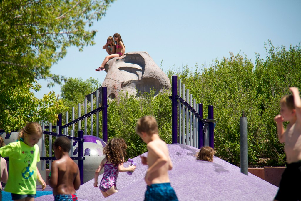 Kids from Westerly Creek Elementary play in Stapleton's Central Park at an end-of-the-year picnic. (Kevin J. Beaty/Denverite)  stapleton; central park; kids; water; play; summer; denverite; denver; colorado; kevinjbeaty