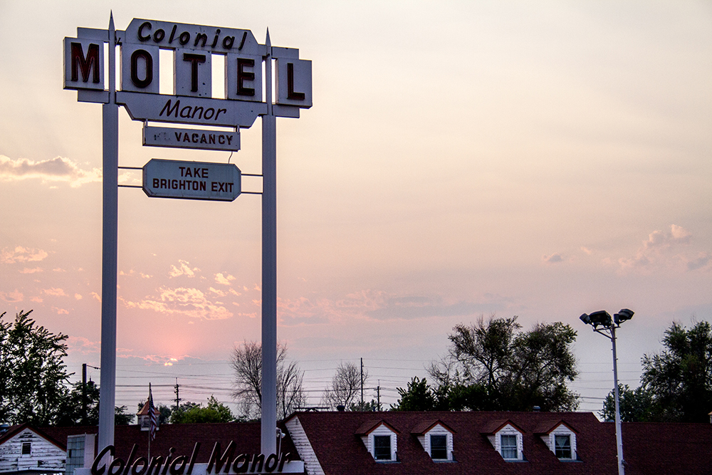 The Colonial Manner Motel, which sits on a dead-end segment of Thompson Court beneath I-70. (Kevin J. Beaty/Denverite)  elyria; swansea; denver; colorado; kevinjbeaty; denverite;