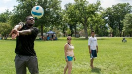 John Jones II bumps a volleyball on the lawn at Washington Park. (Kevin J. Beaty/Denverite)