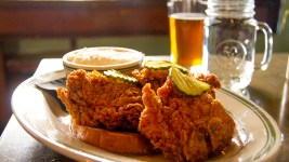 The medium-heat fried chicken at Lou's Food | Bar. There are three thighs here because the joint ran out of chicken twice today. This is all that's left. (Kevin J. Beaty/Denverite)  fried chicken; food; denver; colorado; lous food bar; highlands; kevinjbeaty; denverite;