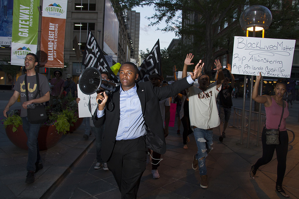 Tay Anderson, Manual High School student body president, leads protests on July 7, 2016. (Kevin J. Beaty/Denverite)  black lives matter 5280; protest; march; denver; colorado; kevinjbeaty; denverite;