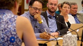 Denver City councilmen Rafael Espinoza and Jolon Clark and councilwoman  Stacie Gilmore listen to testimony at a committee meeting, July 13, 2016. (Kevin J. Beaty/Denverite)